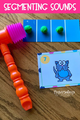 Segmenting sounds using Play Doh and toy hammers