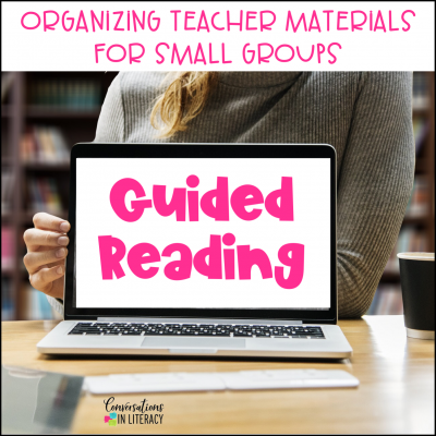 teacher, laptop on desk, guided reading